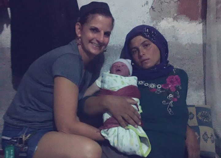 Michelle Ruebke, Certified Professional Midwife in the missions field with children